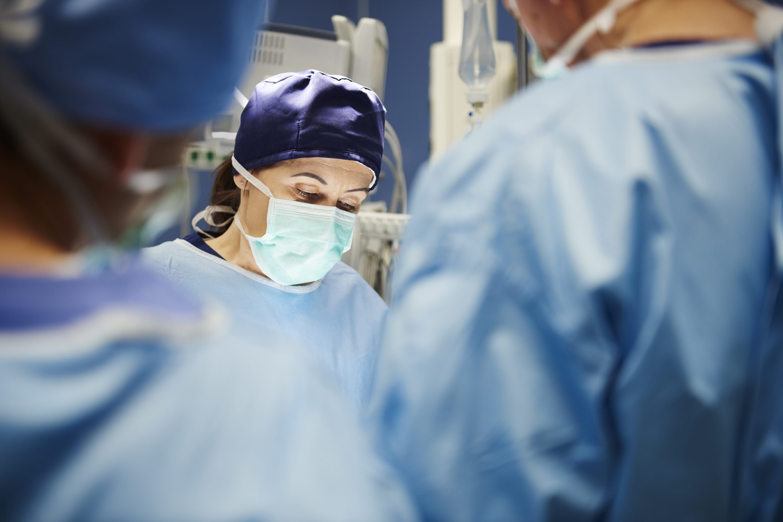 Mature female surgeon during an operation